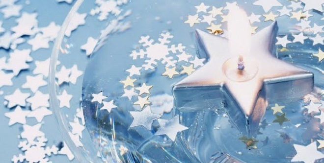 floating-candle-with-silver-stars-and-snowflake-confetti-97384